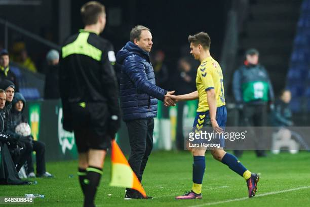 Gregor Sikosek of Brondby IF walks off the pitch after receiving a red card from referee Michael Tykgaard and shake hands with Alexander Zorniger...