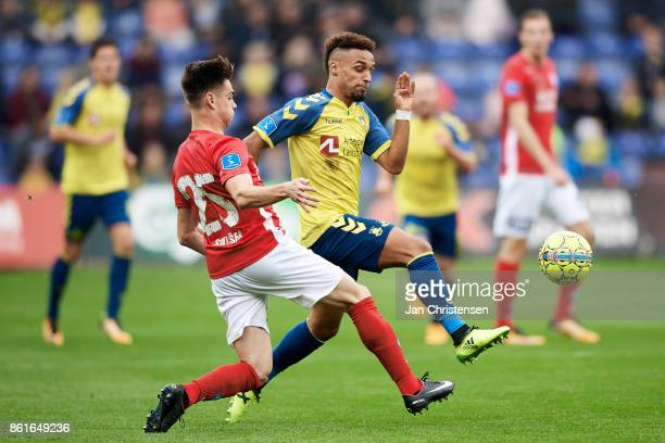 Gregor Sikosek of Silkeborg IF and Hany Mukhtar of Brondby IF compete for the ball during the Danish Alka Superliga match between Brondby IF and...