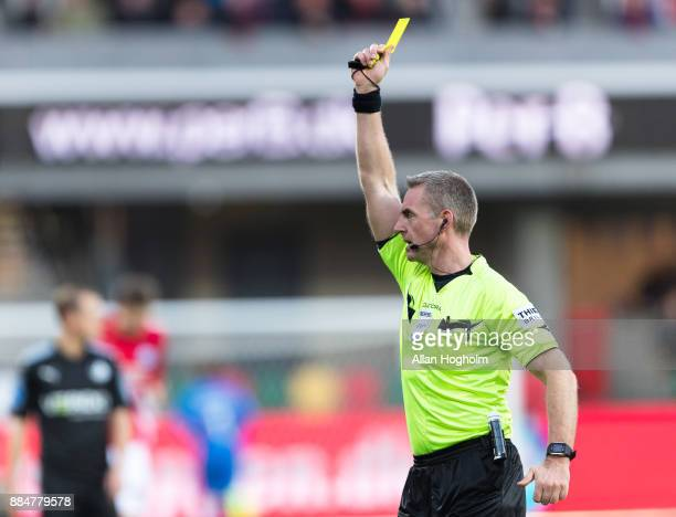 Gregor Sikosek of Silkeborg IF receives a yellow card from Referee Jakob Kehlet during the Danish Alka Superliga match between Silkeborg IF and...