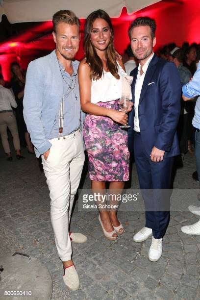 Gregor Teicher Jana Azizi and Sebastian Hoeffner during the 'Audi Director's cut' Party during the Munich film festival at Praterinsel on June 24...