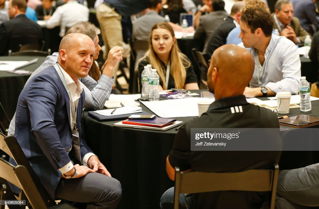 Gregor Townsend, head coach of the Scottish National Rugby team, speaks with a summit attendee at the Leaders Sport Performance Summit on August 29, 2017 in New York City.