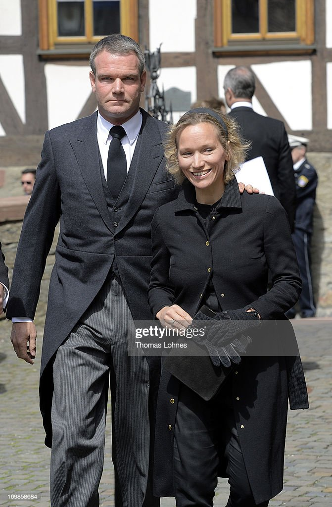 Gregor von Opel and his wife attends the funeral service for Moritz Landgrave of Hesse at St. Johann church at Kronberg on June 3, 2013 in Kronberg, Germany. Moritz of Hesse died at the age of 86 years at May 23 in Frankfurt. He was as great-grandson of the emperor Frederick III. and great-grandson of Queen Victoria related to many European royal houses. The english and the dutch Royal House sent Representatives to the funeral service at Kronberg.