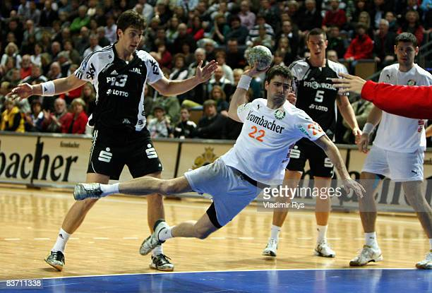 Gregor Werum of Wetzlar shoots on goal as Marcus Ahlm of Kiel defends during the Bundesliga game between HSG Wetzlar and THW Kiel at the Rittal Arena...