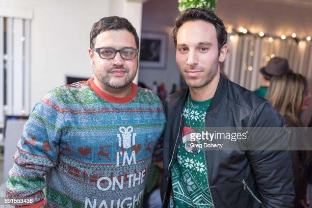 Gregori J Martin and Jake Hunter attend The Bay Ugly Sweater And Secret Santa Christmas Party at Private Residence on December 12 2017 in Los Angeles...