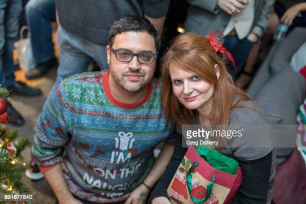 Gregori J Martin and Tiffany Ladner attend The Bay Ugly Sweater And Secret Santa Christmas Party at Private Residence on December 12 2017 in Los...
