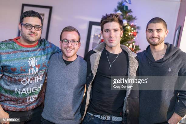 Gregori J Martin Austin Leche Kristos Andrews and Jessie Murphy attend The Bay Ugly Sweater And Secret Santa Christmas Party at Private Residence on...