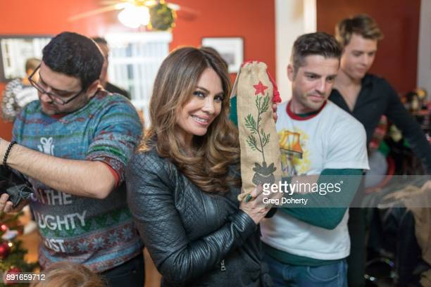 Gregori J Martin Lilly Melgar and Scott Bailey attend The Bay Ugly Sweater And Secret Santa Christmas Party at Private Residence on December 12 2017...