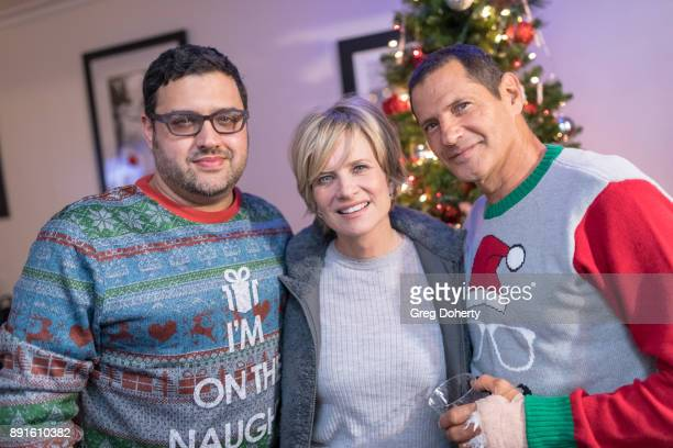 Gregori J Martin Mary Beth Evans and Thomas Collabro attend The Bay Ugly Sweater And Secret Santa Christmas Party at Private Residence on December 12...
