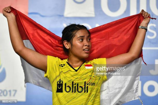 Gregoria Mariska Tunjung of Indonesia celebrates victory after beating Han Yue of China during Women's Singles Final match of the BWF World Junior...