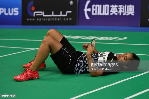 Gregoria Mariska Tunjung of Indonesia falls as she compete against He Bingjiao of China during the EPlus Badminton Asia Team Championships 2018 at...