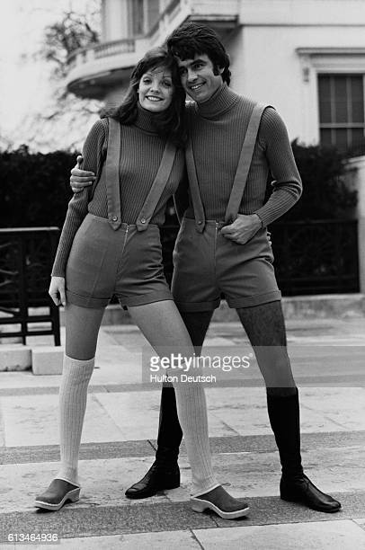 Gregorio and Valerie Jane model fawncolored worsted flannel hot pants and braces by Arthur Harrison and Company of Leeds worn with pink woollen roll...