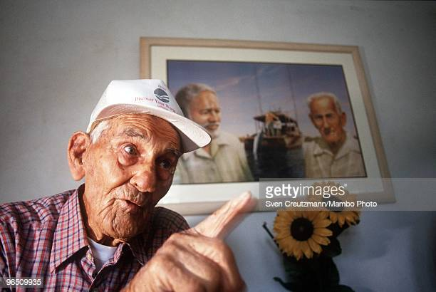 Gregorio Fuentes, former captain on Ernest Hemingway�s fishing boat Pilar, at the age of 100, gestures as he sits in his living room under a painting...