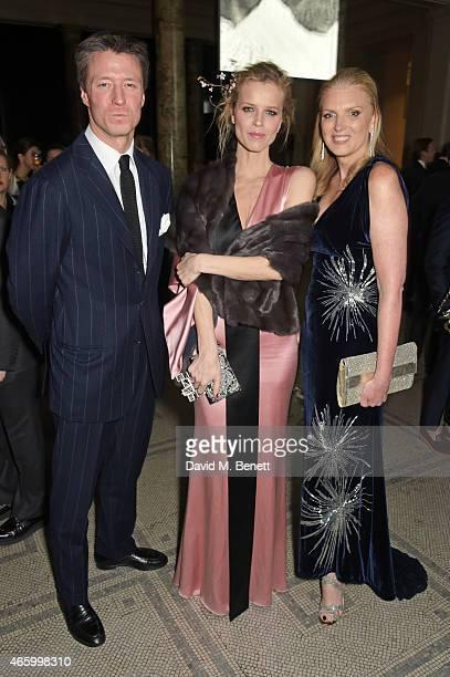 Gregorio Marsiaj Eva Herzigova and Lisa Gregg VP of American Express attends the Alexander McQueen Savage Beauty Fashion Gala at the VA presented by...