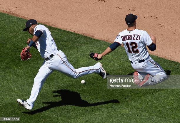 Gregorio Petit and Jake Odorizzi of the Minnesota Twins attempt to make a play on the ball hit by Tyler Saladino of the Milwaukee Brewers during the...