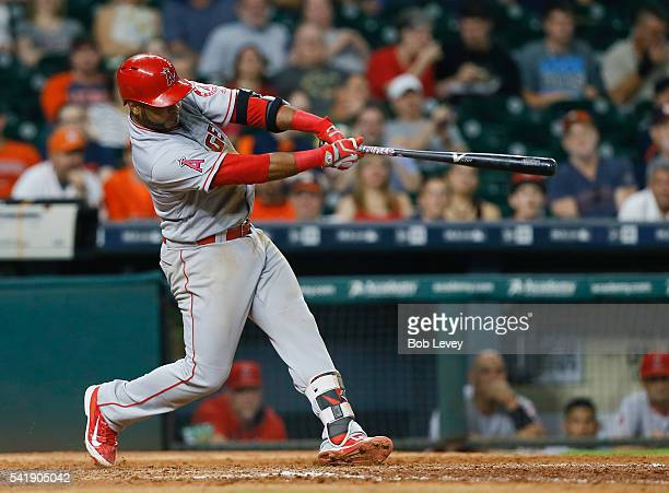 Gregorio Petit of the Los Angeles Angels of Anaheim hits a grand slam in the ninth inning against the Houston Astros at Minute Maid Park on June 20...