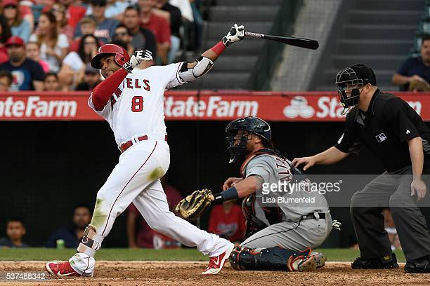 Gregorio Petit of the Los Angeles Angels of Anaheim hits a ground rule double in the eighth inning against the Detroit Tigers at Angel Stadium of...