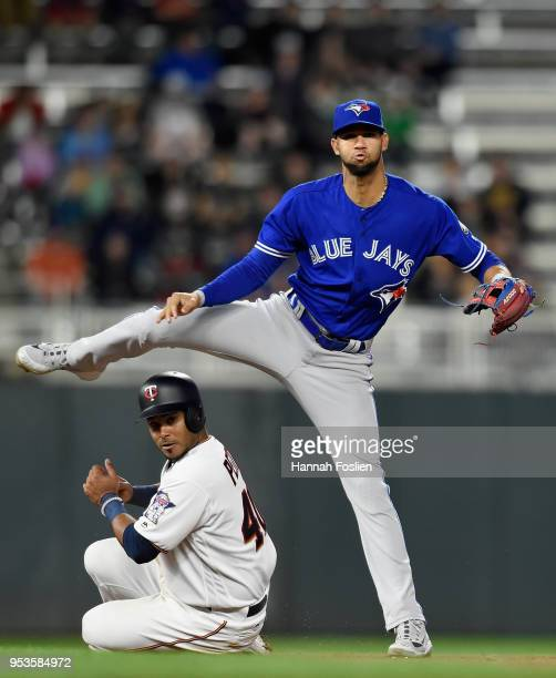 Gregorio Petit of the Minnesota Twins is out at second base as Lourdes Gurriel of the Toronto Blue Jays turns a double play during the seventh inning...