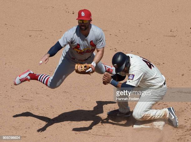 Gregorio Petit of the Minnesota Twins is out at second base as Paul DeJong of the St Louis Cardinals turns a double play during the fifth inning of...