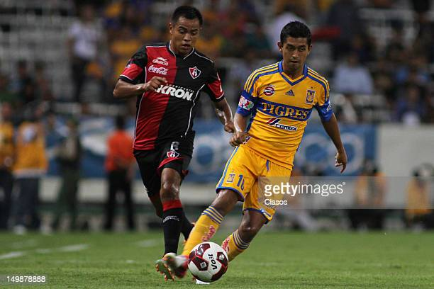 Gregorio Torres of Atlas and Elias Hernandez of Tigres fight for the ball during the a match Between Atlas and Tigres as part of the Torneo Apertura...