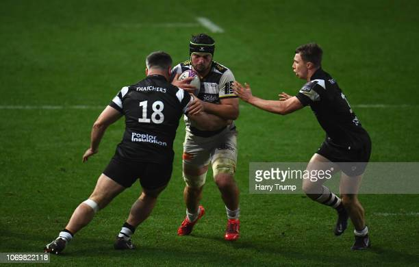 Gregory Aldritt of La Rochelle is tackled by Jake Armstrong and Charlie Powell of Bristol Bears during the Challenge Cup match between Bristol Bears...