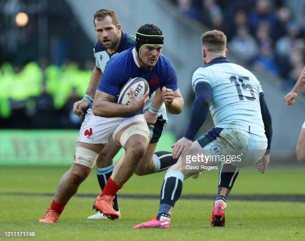Gregory Alldritt of France runs past Stuart Hogg of Scotland during the 2020 Guinness Six Nations match between Scotland and France at Murrayfield on...