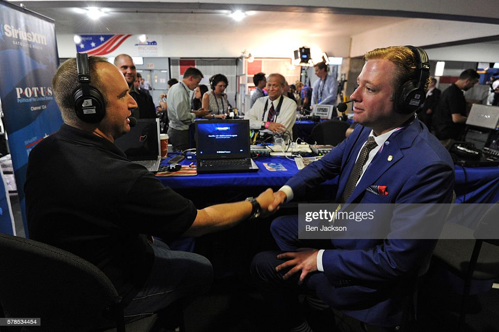 Gregory Angelo, President of Log Cabin Republicans, shakes hands with Andrew Wilkow following a live broadcast of The Wilkow Majority on SiriusXM Patriot at Quicken Loans Arena on July 21, 2016 in Cleveland, Ohio.
