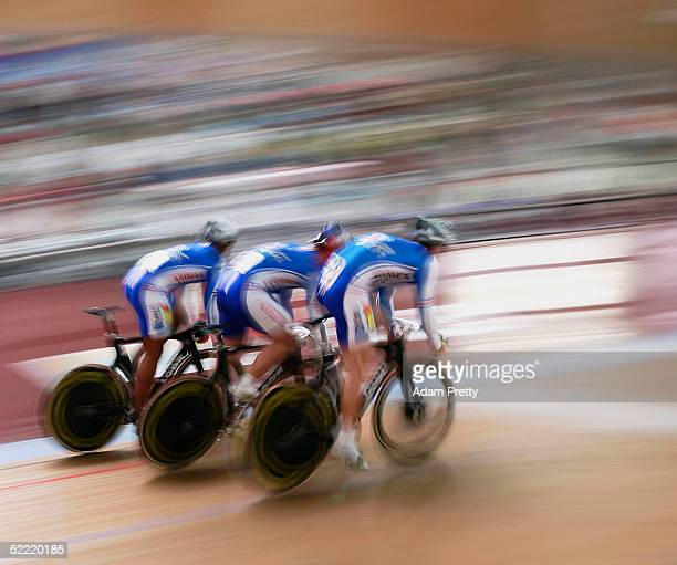 Gregory Bauge Arnaud Tournant and Francois Pervis of France on their way to Gold in the mens Team Sprint during day three of the UCI Track Cycling...
