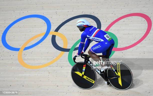 Gregory Bauge of France celebrates after winning the bronze medal in the Men's Team Sprint competition at the Olympic Velodrome in Barra during the...