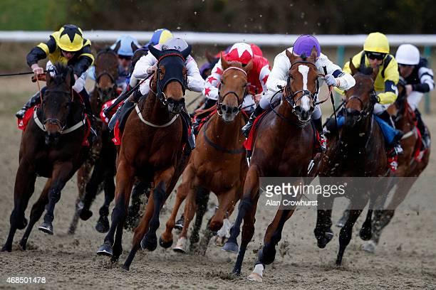 Gregory Benoist riding Fresles wins The 32Redcom AllWeather Fillies' And Mares' Championships Conditions Stakes at Lingfield racecourse on April 03...