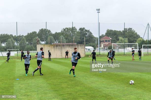 Edson Seidou of Red Star and Red Star coach Regis Brouard during the first training session of the new season for Red Star on June 18 2018 in Paris...