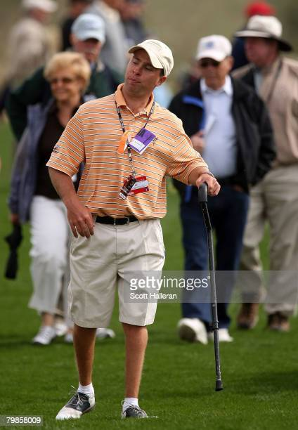 Gregory, born with cerebral palsy, who plans to attend all 37 FedEx Cup events in 2008, follows the play during the first-round matches of the...