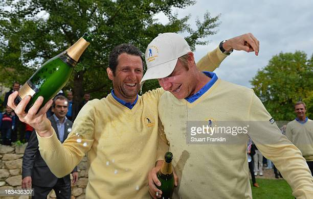 Gregory Bourdy and Mikko Ilonen of the European team celebrate with champagne after winning the Seve Trophy at Golf de SaintNomlaBreteche on October...