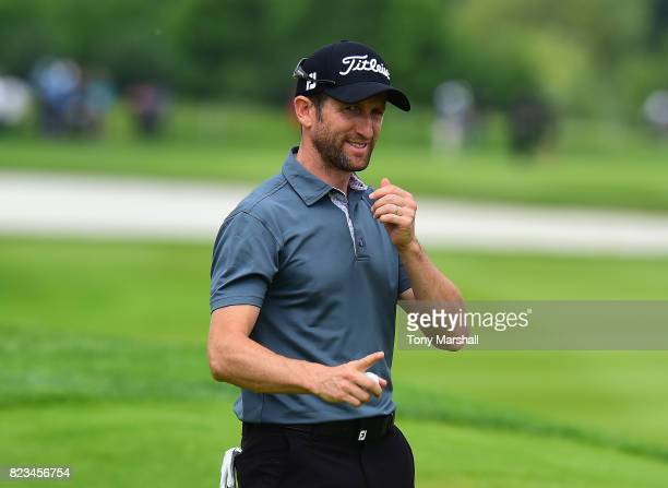 Gregory Bourdy of France acknowledges the applause from the croud as he finishes his first round during the Porsche European Open Day One at Green...