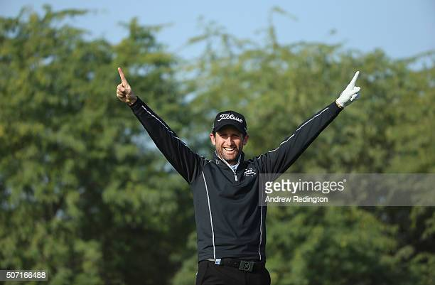 Gregory Bourdy of France celebrates after making a holeinone on the eighth hole during the second round of the Commercial Bank Qatar Masters at Doha...