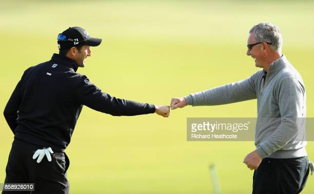 Gregory Bourdy of France celebrates with his partner Aidan Heavey after making berdie on the 1st during the final round of the 2017 Alfred Dunhill...