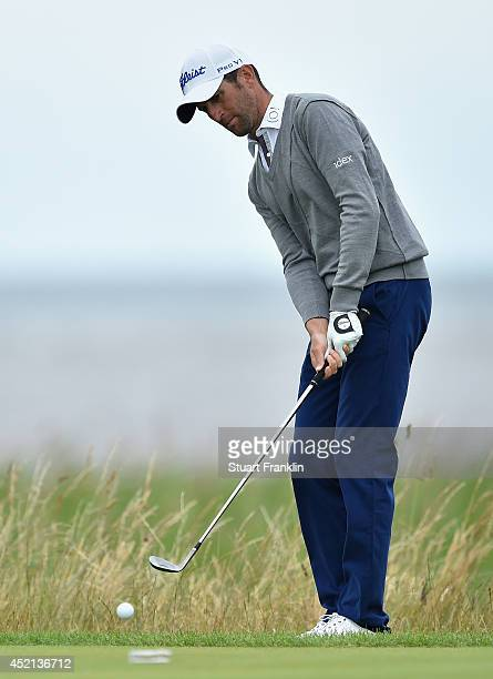 Gregory Bourdy of France chips during a practice round prior to the start of the 143rd Open Championship at Royal Liverpool on July 14 2014 in...
