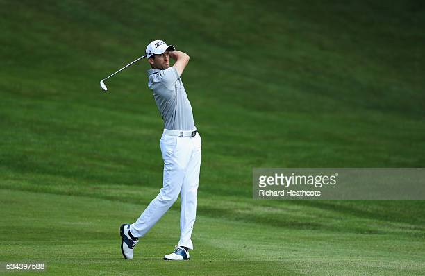 Gregory Bourdy of France hits his 2nd shot on the 4th hole during day one of the BMW PGA Championship at Wentworth on May 26 2016 in Virginia Water...