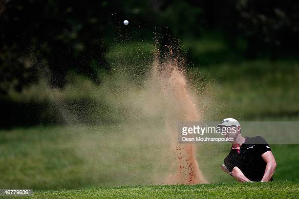 Gregory Bourdy of France hits his second shot on the 2nd hole out of the bunker during Day Three of the Joburg Open at Royal Johannesburg and...