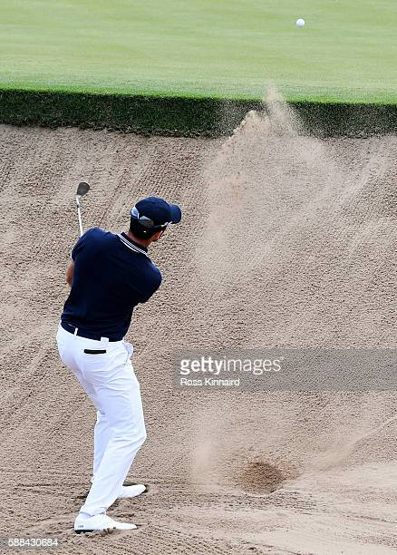 Gregory Bourdy of France plays a shot from a bunker on the 16th hole during the first round of men's golf on Day 6 of the Rio 2016 Olympics at the...