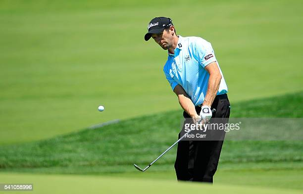 Gregory Bourdy of France plays a shot on the 18th hole during the continuation of the second round of the US Open at Oakmont Country Club on June 18...