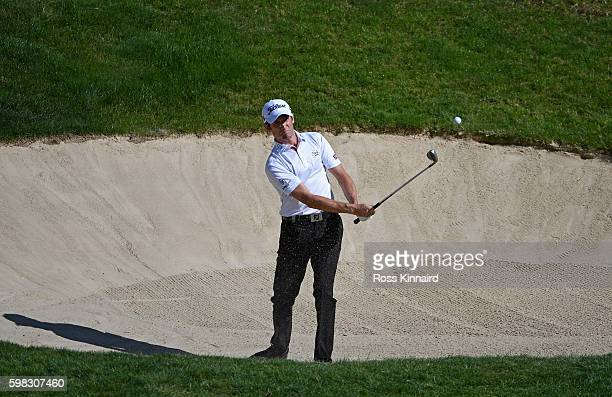 Gregory Bourdy of France plays his second shot on the 13th hole during the first round of the Omega European Masters at CranssurSierre Golf Club on...
