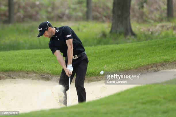 Gregory Bourdy of France plays out of a bunker on the ninth hole during day one of the BMW PGA Championship at Wentworth on May 25 2017 in Virginia...