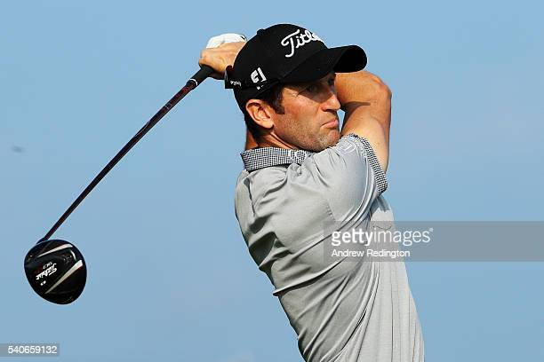 Gregory Bourdy of France watches his tee shot on the 12th hole during the first round of the US Open at Oakmont Country Club on June 16 2016 in...