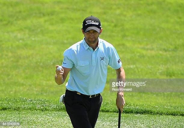 Gregory Bourdy of France waves to the gallery after a birdie on the 13th hole during the continuation of the second round of the US Open at Oakmont...