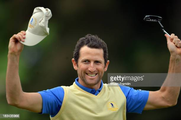 Gregory Bourdy of the European team celebrates winning his match and becoming the first player ever to be unbeaten in the Seve Trophy during the...