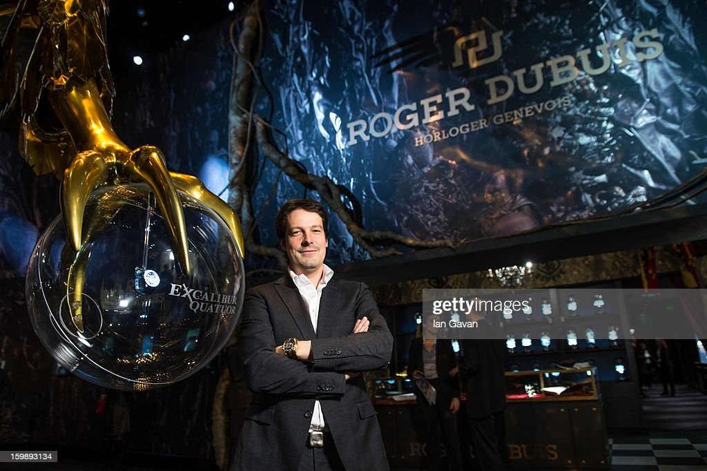 Gregory Bruttin, Director of movement development poses with the Excalibur Quatuor watch as he visits the Roger Dubuis booth during the 23rd Salon International de la Haute Horlogerie at the Geneva Palexpo on January 22, 2013 in Geneva, Switzerland.