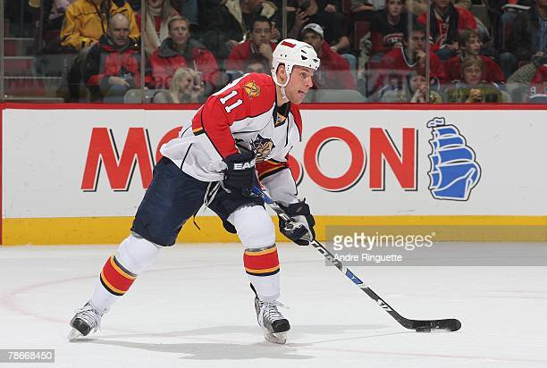 Gregory Campbell of the Florida Panthers looks to pass against the Montreal Canadiens at the Bell Centre on December 18, 2007 in Montreal, Quebec,...