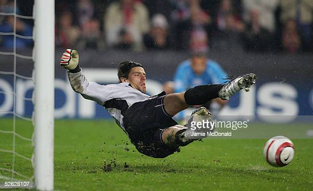 Gregory Coupet of Lyon saves a penalty during the UEFA Champions League quarter final, second leg match between PSV Eindhoven and Olmpique Lyonnais...