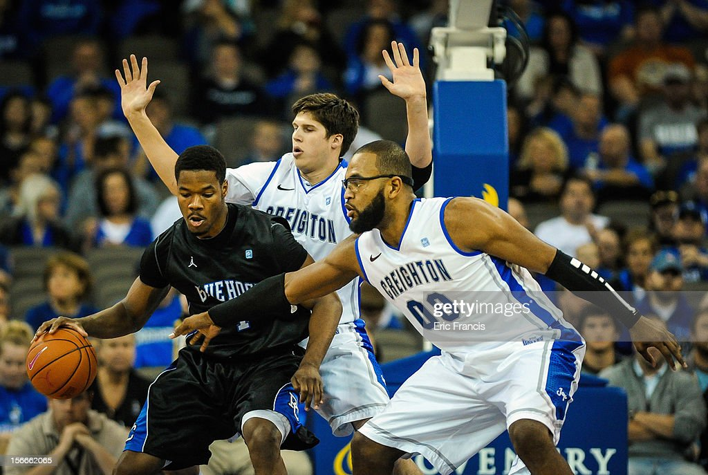 Gregory Echenique #0 and Doug McDermott #3 of the Creighton Bluejays guard Joshua Clyburn #1 of the Presbyterian Blue Hose during their game at CenturyLink Center on November 18, 2012 in Omaha, Nebraska.