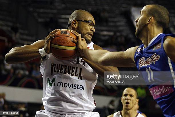 Gregory Echenique fights for the ball with Ricardo Sanchez of Puerto Rico during their 2011 FIBA Americas Championship qualifying round game on...